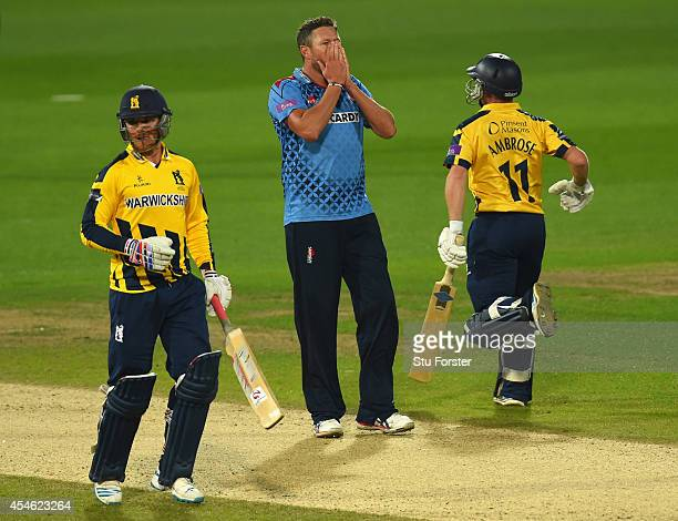 Kent bowler Mitchell Claydon reacts as Warwickshire batsmen Laurie Evans and Tim Ambrose pick up runs during the Royal London OneDay Cup 2014 Semi...