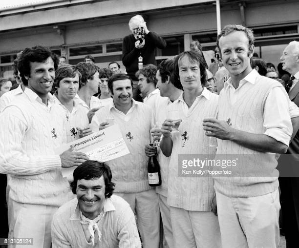 Kent captain Asif Iqbal celebrates with his teammates on becoming jointwinners of the Schwepppes County Championship after Kent's win over...