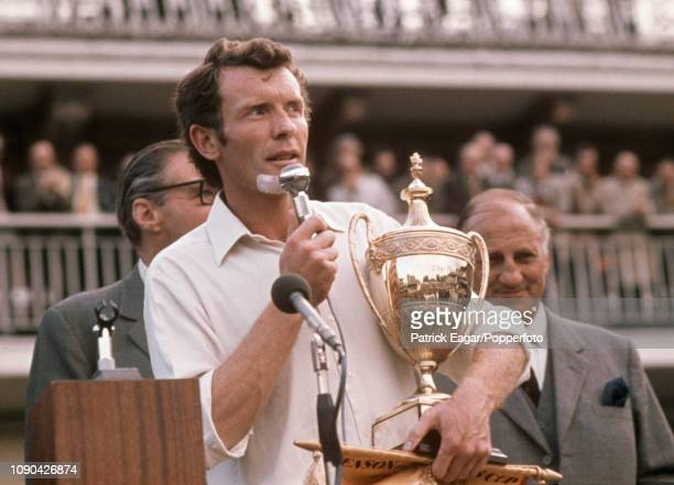Kent captain Mike Denness clutching the trophy and winner's pennant addresses the crowd during the presentation ceremony after Kent won the Benson...