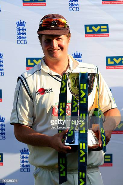 Kent captain Robert Key holds the championship trophy after the LV County Championship Division Two match between Kent and Leicestershire at The St...