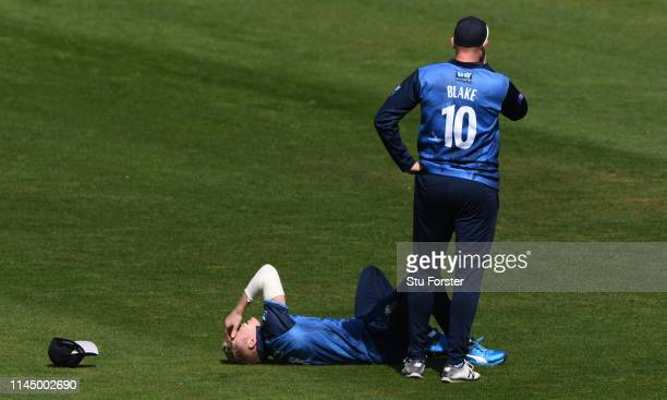 Kent captain Sam Billings reacts after an injury in the field during the Royal London One Day Cup match between Glamorgan and Kent at Sophia Gardens...