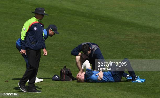 Kent captain Sam Billings reacts as he receives treatment after an injury in the field during the Royal London One Day Cup match between Glamorgan...