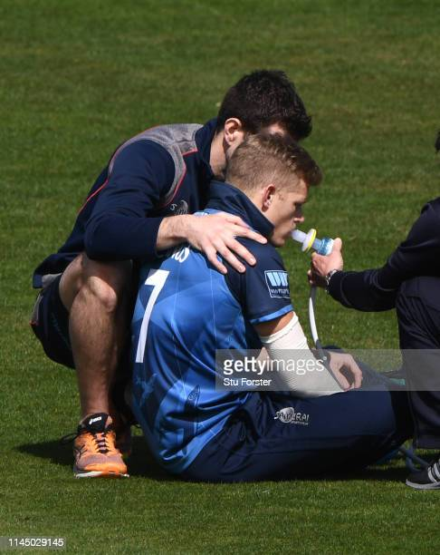 Kent captain Sam Billings receives oxygen after an injury to his shoulder in the field during the Royal London One Day Cup match between Glamorgan...