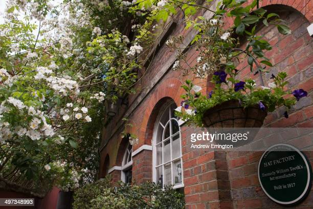 Kent Cranbrook plants and shrubs tended and belonging to residents decorate public alleyway outside the front door of a house formerly a hat factory