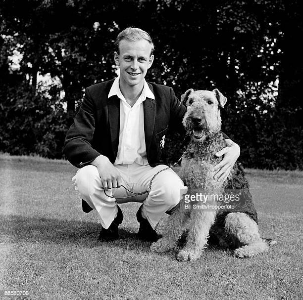 Kent cricketer Derek Underwood with his Airedale terrier named 'Rustler' circa 1965