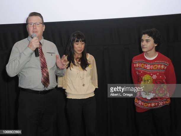 Kent Cromwell addresses the audience along with teacher Samantha Leon and Hunter Payton at the Hunter Payton And The Shoe Crew Holiday Charity...
