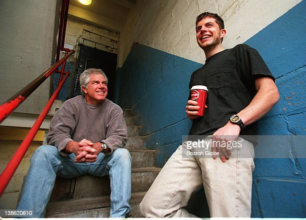 Kent Damon father of actor Matt Damon talks with his other son Kyle outside Kyle's studio in Medford Both are excited about attending Monday's...