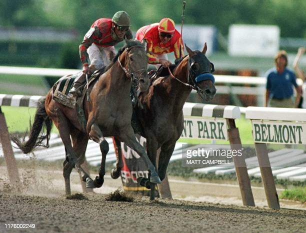 Kent Desmoreaux aboard Real Quiet and Gary Stevens aboard Victory Gallop battle for the finish line of the Belmont Stakes 06 June Victory Gallup won...