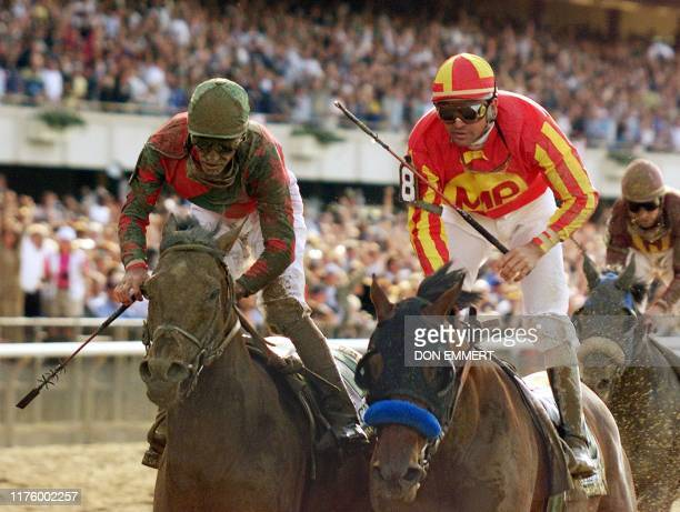 Kent Desmoreaux aboard Real Quiet and Gary Stevens aboard Victory Gallop cruises past the finish 06 June in the Belmont Stakes The favorite Real...