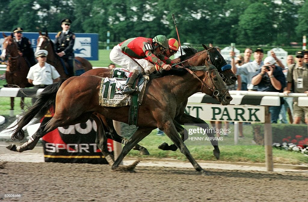 Kent Desmoreaux aboard Real Quiet (in back) and Gary Stevens aboard Victory Gallop approach the finish line of the Belmont Stakes 06 June. Victory Gallup won the race in a photo finish denying favorite Real Quiet the Triple Crown by the narrowest of margins. Victory Gallup had finished runner-up to Real Quiet at the Kentucky Derby and the Preakness.