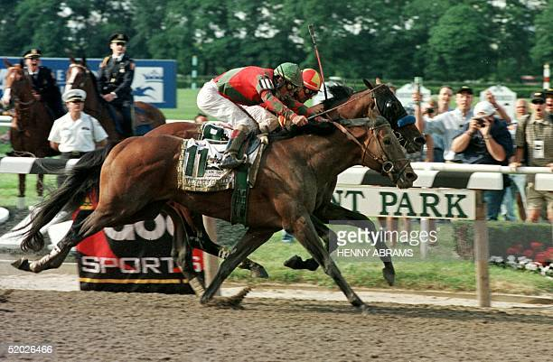Kent Desmoreaux aboard Real Quiet and Gary Stevens aboard Victory Gallop approach the finish line of the Belmont Stakes 06 June Victory Gallup won...