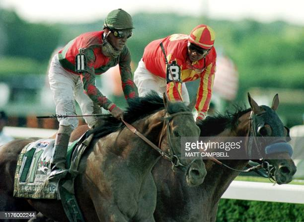 Kent Desmoreaux aboard Real Quiet looks at Gary Stevens aboard Victory Gallop after crossing the finish line of the Belmont Stakes 06 June Victory...