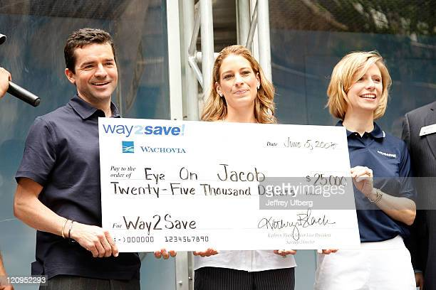 Kent Desormeaux and Sonia Desormeaux receive a check from Wachovia to benefit the Eye on Jacob Foundation at the Final Stop on the Wachovia Way2Save...