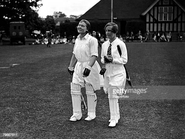 Kent, England, 11th July Miss Thomas and Miss Cattell going ou to bat during a Women's cricket match at the Hong Kong Bank ground at Beckenham, Kent