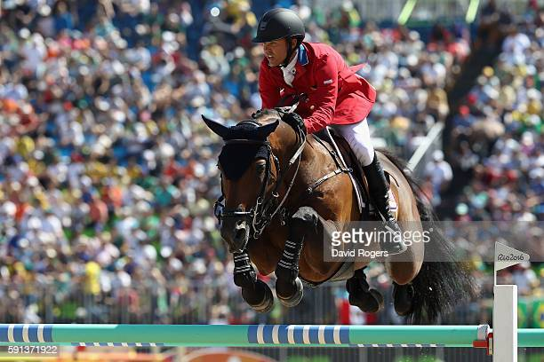 Kent Farrington of the United States rides Voyeur during the Jumping Team Round 2 on Day 12 of the Rio 2016 Olympic Games at the Olympic Equestrian...