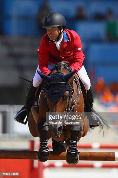 Kent Farrington of the United States rides Voyeur during the Team Jumping on Day 11 of the Rio 2016 Olympic Games at the Olympic Equestrian Centre on...