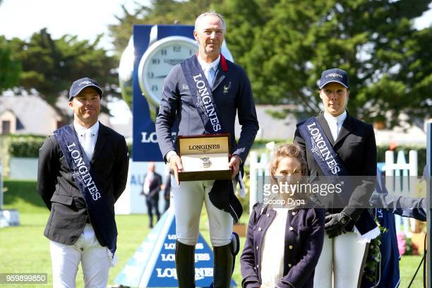 Kent FARRINGTON Patrice DELAVEAU and Gudrun PATTEET riding AQUILA HDC during the Grand Prix Longines of the International Jumping La Baule 2018 on...