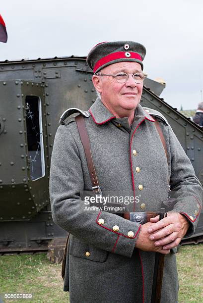 UK Kent Headcorn Military Airshow man taking part in history reenactment of First World War German Army with tank behind