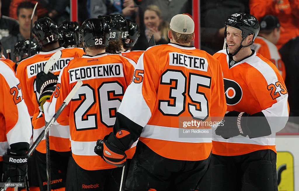 Kent Huskins #23 and Cal Heeter #35 of the Philadelphia Flyers celebrate with teammates after defeating the Montreal Canadiens 5-3 on April 3, 2013 at the Wells Fargo Center in Philadelphia, Pennsylvania.