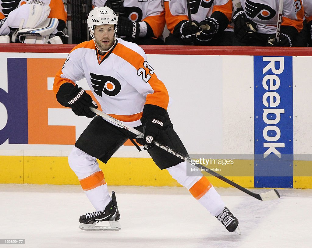 Kent Huskins #23 of the Philadelphia Flyers watches the play as he skates on the ice during third period in a game between the Winnipeg Jets and the Philadelphia Flyers on April 6, 2013 at the MTS Centre in Winnipeg, Manitoba, Canada.