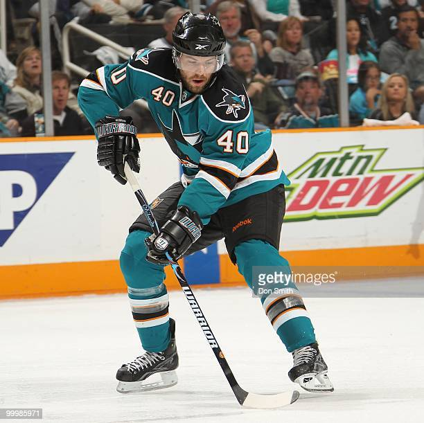 Kent Huskins of the San Jose Sharks moves the puck in Game One of the Western Conference Finals during the 2010 NHL Stanley Cup Playoffs against the...