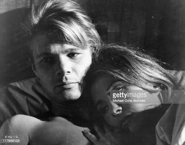 Kent Lane lies in bed with Michele Carey in a scene from the film 'Changes' 1969