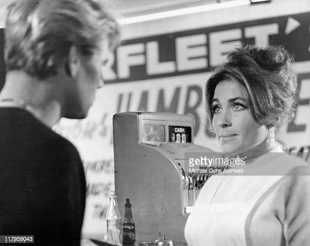 Kent Lane looks into Michele Carey's eyes in a scene from the film 'Changes' 1969