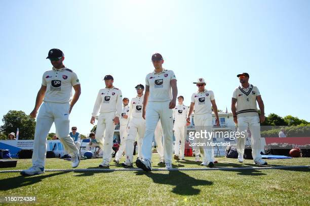 Kent make their way to the field to open the fielding on day two of the Specsavers County Championship Division One match between Kent and Surrey on...