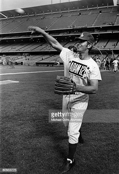 Kent McCord costar of the hit 1970's TV show Adam 12 warms up before a charity baseball game against real cops on September 5 1972 at Dodger Stadium...