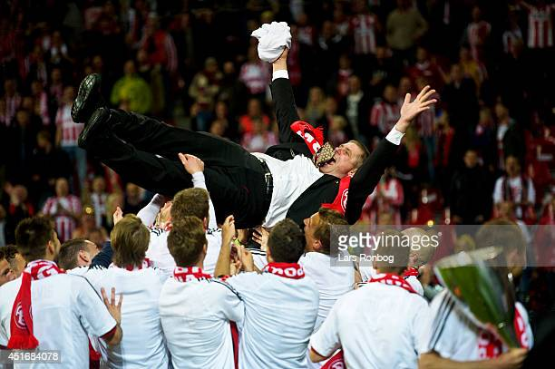 Kent Nielsen head coach of AaB Aalborg is thrown in the air by his players after winning the DBU Pokalen Cup Final match between AaB Aalborg and FC...