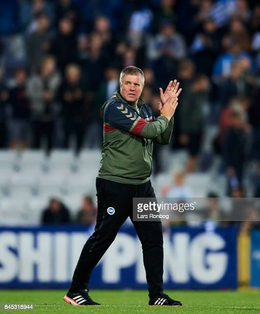 Kent Nielsen head coach of OB Odense applause after the Danish Alka Superliga match between OB Odense and Brondby IF at EWII Park on September 10...