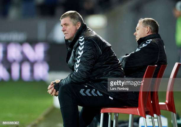 Kent Nielsen head coach of OB Odense din the bench during the Danish Alka Superliga match between FC Midtjylland and OB Odense at MCH Arena on...