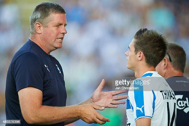 Kent Nielsen head coach of OB Odense gives instructions to Jens Jakob Thomasen of OB Odense during the Danish Alka Superliga match between OB Odense...