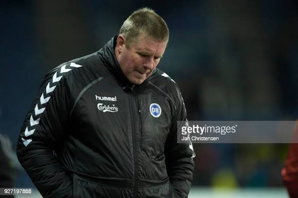 Kent Nielsen head coach of OB Odense looks dejected after the Danish Alka Superliga match between Brondby IF and OB Odense at Brondby Stadion on...