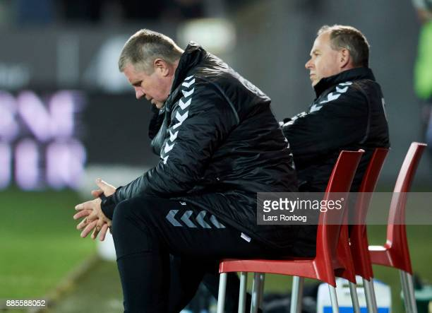 Kent Nielsen head coach of OB Odense looks dejected during the Danish Alka Superliga match between FC Midtjylland and OB Odense at MCH Arena on...