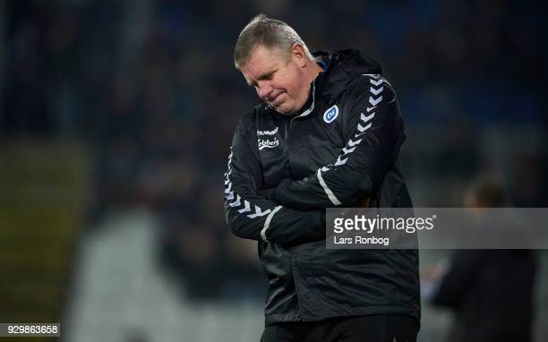 Kent Nielsen head coach of OB Odense looks dejected during the Danish Alka Superliga match between OB Odense and AGF Aarhus at EWII Park on March 9...