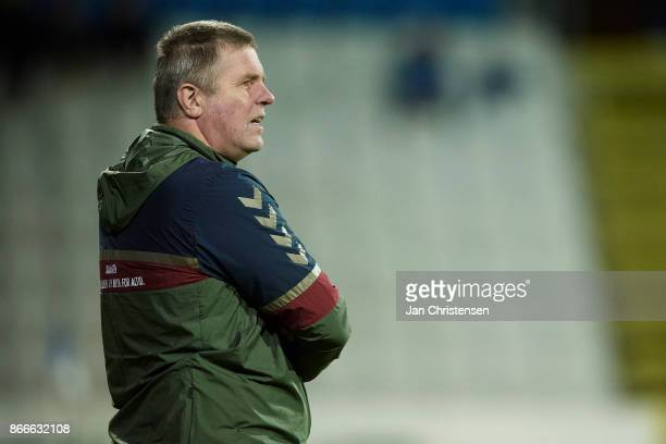 Kent Nielsen head coach of OB Odense looks on during the Danish Cup DBU Pokalen match between OB Odense and FC Midtjylland at TREFOR Park on October...