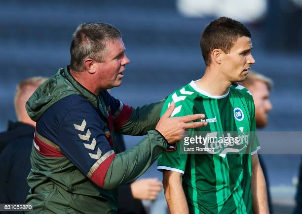 Kent Nielsen head coach of OB Odense speaks to Nicklas Helenius of OB Odense during the Danish Alka Superliga match between AGF Aarhus and OB Odense...