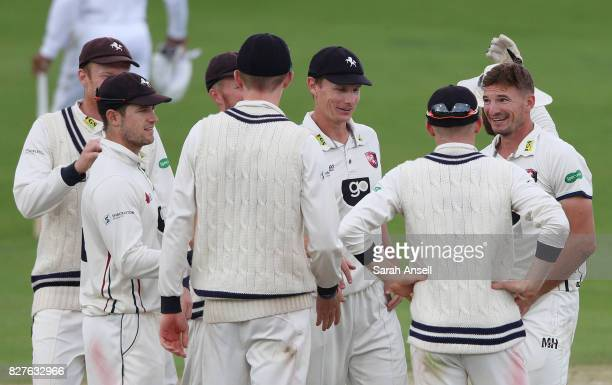 Kent players celebrate after bowler Charlie Hartley takes the wicket of Shai Hope of West Indies during day 3 of the match between Kent and West...