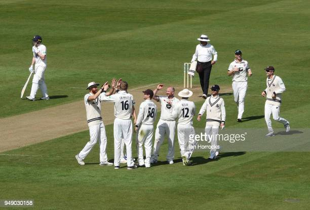 Kent players celebrate taking the wicket of Nathan Rimmington of Durham during day one of the SpecSavers County Championship Division Two match...