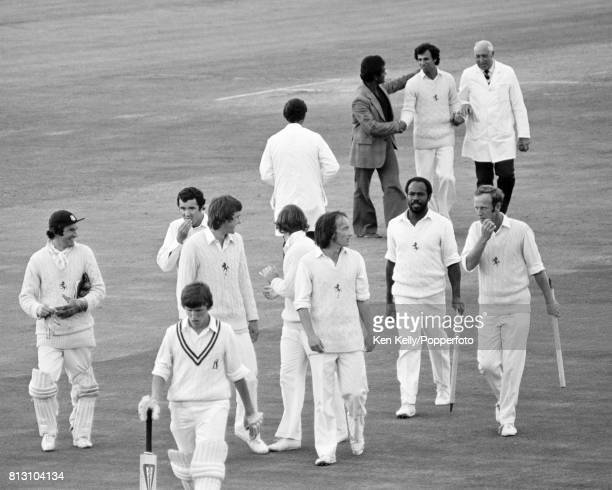 Kent players walk off the field after winning the Schweppes County Championship match between Warwickshire and Kent by 27 runs at Edgbaston...