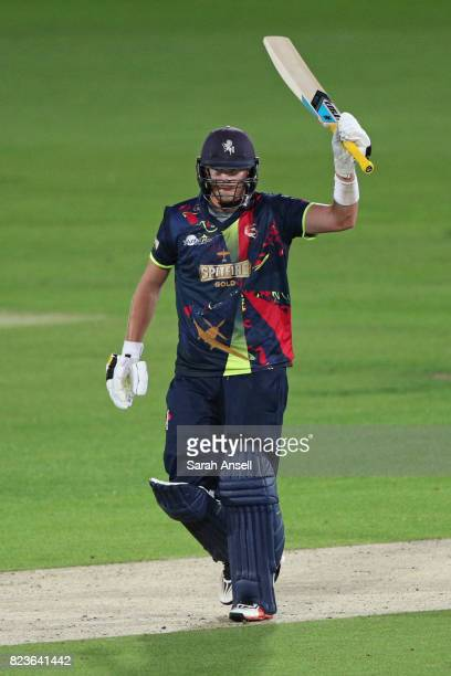 Kent Spitfires captain Sam Northeast raises his bat after reaching a half century during the NatWest T20 Blast South Group match at The Spitfire...