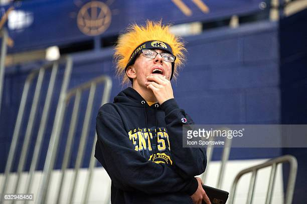 Kent State fan in the stands during overtime of the college men's basketball game between the Central Michigan Chippewas and Kent State Golden...