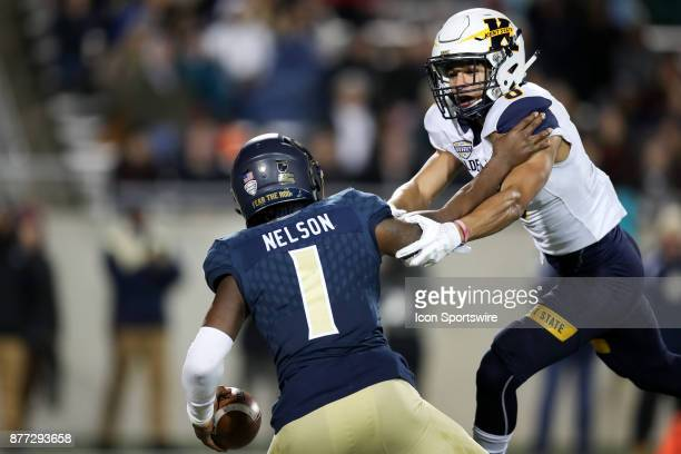 Kent State Golden Flashes defensive back Elvis Hines sacks Akron Zips quarterback Kato Nelson during the second quarter of the college football game...