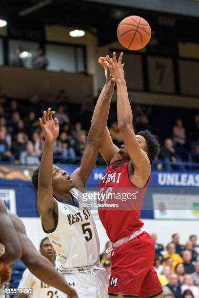 Kent State Golden Flashes F Danny Pippen defends the shot attempt of Miami RedHawks F Marcus Weathers first half of the men's college basketball game...