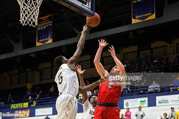 Kent State Golden Flashes F Danny Pippen deflects the shot of Ball State Cardinals G Tayler Persons during the second half of the NCAA Men's...