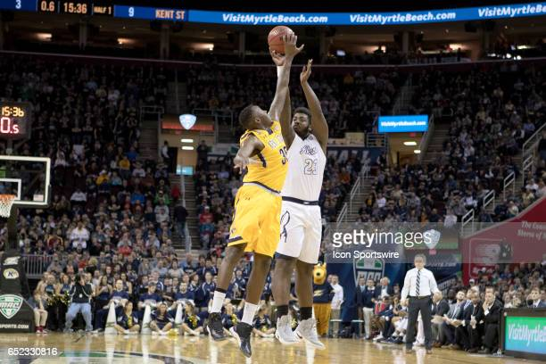 Kent State Golden Flashes F Jimmy Hall blocks the shot of Akron Zips C Isaiah Johnson during the first half of the MAC mens basketball tournament...