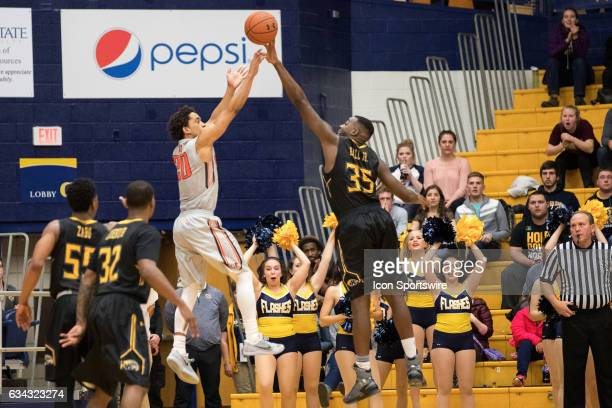 Kent State Golden Flashes F Jimmy Hall blocks the shot of Bowling Green Falcons G Ismail Ali at the buzzer to send the game to overtime during...