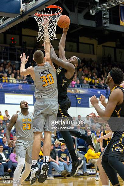 Kent State Golden Flashes F Jimmy Hall goes up for a shot against Toledo Rockets F/C Luke Knapke during the second half of the NCAA Men's Basketball...