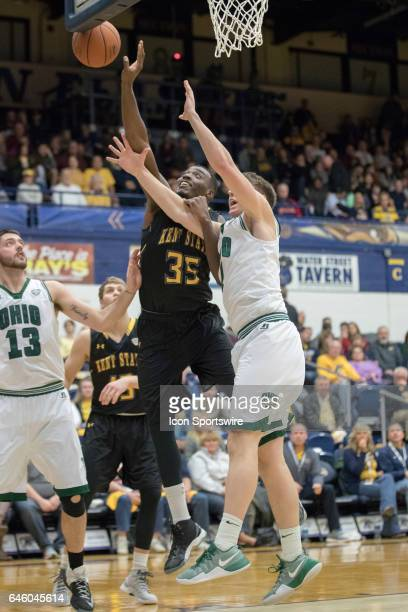 Kent State Golden Flashes F Jimmy Hall is called for a foul as he holds the arm of Ohio Bobcats F Jason Carter while going for a rebound during the...